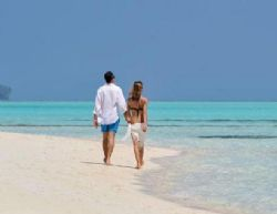 Lifestyle - Couple strolls on sandy beach